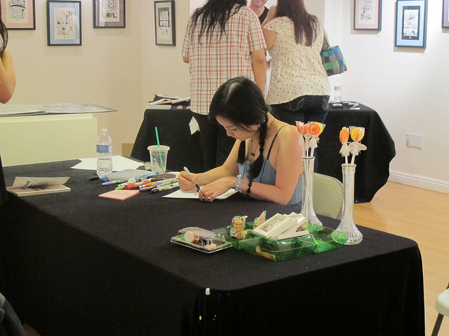 Junko Mizuno signing autographs at the Hansel & Gretel show at Gallery Nucleus.