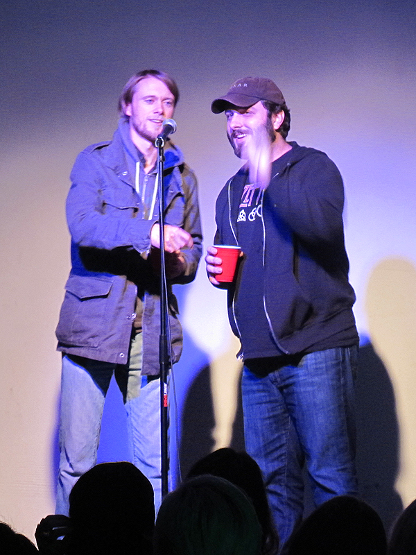 "Zack Keller and John Dusenberry, creators of ""Duke of Fancy,"" giving a speech before a screening of shorts for YouTube animation channel Rug Burn."