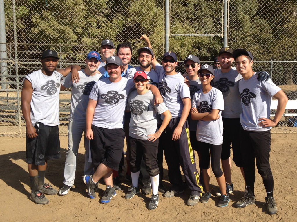 "The Family Guy softball team with ""Children's Hospital"" second assistant director M. Ryan Traylor pretending to be Seth MacFarlane. Back row: Patrick Clark. Middle row (left to right): J. Lee, Shawn Ries, M. Ryan Traylor, Francis Lucas's brother, Andrew Goldberg, and Matt Gerardi. Front (left to right): Drew Graziano, Lisa Hallbauer, Francis Lucas, Kristina Bustamante, and Kyle Lau."
